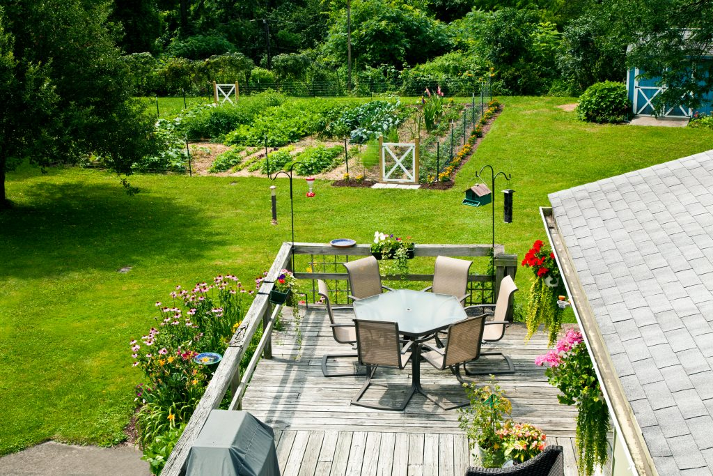 Deck and vegatable garden of an Upstate New York home